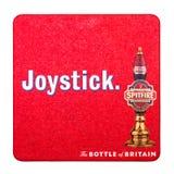 LONDON, UK - FEBRUARY 04, 2018: Spitfire kenitish ale original beermat coaster isolated on white. LONDON, UK - FEBRUARY 04, 2018: Spitfire kenitish ale original royalty free stock photography