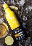 LONDON, UK - FEBRUARY 06, 2019: Steel Bottle of Corona Extra Beer Sunset Edition on wooden background with bottle opener and ice. Cubes. Corona, produced by stock photos