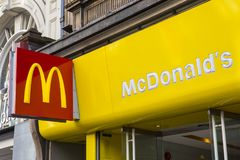 McDonalds on Oxford Street in London. LONDON, UK - FEBRUARY 16TH 2018: The logo of the McDonalds restaurant located on Oxford Street in London, on 16th February Royalty Free Stock Photo
