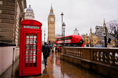 London, UK-FEBRUARY 12: Traditional red telephone box in the rainy day with the Big Ben and red bus in the background Stock Photo