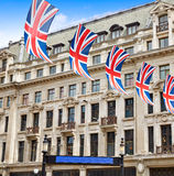 London UK flags in Oxford Street W1 Royalty Free Stock Image