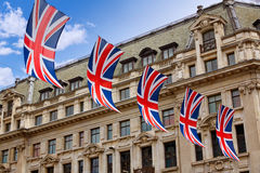 London UK flags in Oxford Street W1 Stock Image