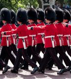 Guardsmen and women march down the The Mall, Westminster UK during the Trooping the Colour annual military parade royalty free stock image