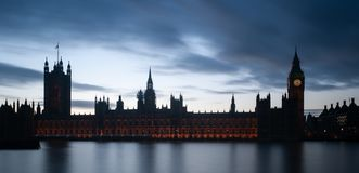 London, UK - Intentionally under-exposed panoramic view of The Houses of Parliament and the Big Ben. Silhouetted against sky at dusk. London exposure shot royalty free stock photography