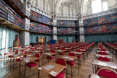 Interior of the Octagon Library at Queen Mary, University of London in Mile End, East London, with colourful leather bound books. London UK. Interior of the royalty free stock image