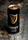 LONDON, UK - JANUARY 20, 2018:Aluminium can of Guinness draught beer on stone. Guinness beer has been produced since 1759 in Dubli. LONDON, UK - JANUARY 20, 2018 Royalty Free Stock Images