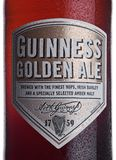 LONDON, UK - JANUARY 02, 2018:  Bottle label of Guinness golden ale beer on white. Guinness beer has been produced since 1759 in D. LONDON, UK - JANUARY 02, 2018 Stock Photo