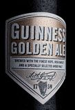LONDON, UK - JANUARY 02, 2018:  Bottle label of Guinness golden ale beer on white. Guinness beer has been produced since 1759 in D. LONDON, UK - JANUARY 02, 2018 Royalty Free Stock Photos
