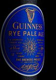 LONDON, UK - JANUARY 02, 2018:  Bottle label of Guinness rye pale ale beer on white. Guinness beer has been produced since 1759 in. LONDON, UK - JANUARY 02, 2018 Royalty Free Stock Photos