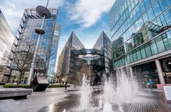 Fontain near City Hall and modern glass buildings in London, UK Stock Image