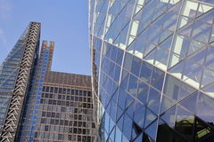 LONDON, UK - JANUARY 25, 2016: The Gherkin with The Leadenhall Building and The Aviva Building in the financial district of the Ci Stock Images