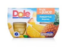 LONDON, UK - JANUARY 02, 2018: Packages of Dole fruit in juice in individual cups on white. Royalty Free Stock Photo