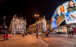 Piccadilly Circus with billboards,people and city traffic in Lon. London, UK- January 10, 2018:Piccadilly Circus with billboards,people and city traffic in Royalty Free Stock Photos