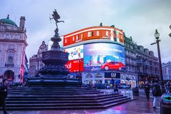 Piccadilly Circus is a famous London landmark and busy destination for tourists. LONDON, UK - JANUARY 12, 2017: Piccadilly Circus with the Shaftesbury Memorial royalty free stock photos