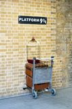 Platform nine and three quarters at London`s King`s Cross statio. LONDON, UK - JANUARY 22, 2013 - Platform nine and three quarters at London`s `s Cross station royalty free stock images