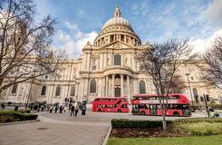 Red busses in front of Saint Pauls Cathedral in London, UK. London, UK- January 10, 2018:Red busses in front of Saint Pauls Cathedral in London, UK Stock Photography