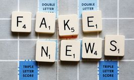 Fake News - Concept game spelling Fake News Royalty Free Stock Image