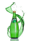 LONDON, UK -JANUARY 02, 201t: Bottle of Perrier sparkling water with splash. Perrier is a French brand of natural bottled mineral Royalty Free Stock Image