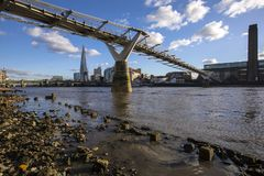 View from the Shore of the River Thames. London, UK - January 28th 2019: A view from the shore of the River Thames in London. This view takes in the sights of stock photo