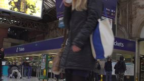 LONDON, UK. January 19, 2017. Ticket office on Victoria Station with people stock footage