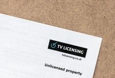 London/UK - Juli 1st 2019 - bokstav från TV som licenserar företaget som påstår att egenskapen är olicensierad royaltyfri fotografi