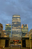 London, UK. LONDON, UK - JULY 1, 2014: Some of the tallest skyscrapers in the Canary Wharf business district seen from Cabot Square at night Stock Image