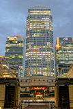 London, UK. LONDON, UK - JULY 1, 2014: Some of the tallest skyscrapers in the Canary Wharf business district seen from Cabot Square at night royalty free stock image