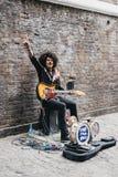 Street performer singing on Brick Lane, London, UK. royalty free stock images