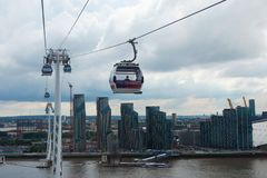LONDON, UK  Emirates cable car crosses the Thames from Excel centre to the O2 stock image