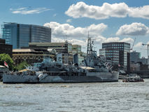 LONDON, UK - JUN 14 : HMS Belfast anchored near Tower Bridge in Stock Photography
