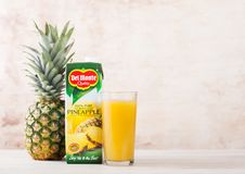 LONDON, UK - JUNE 30, 2018: Pack Of Del Monte Pineapple Juice On Wooden Background With Glass And Raw Pineapple. Stock Photos