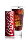 LONDON, UK - JUNE 9, 2017: Aluminium can with glass can of Coca cola soft drink on white.The Coca-Cola Company, an American multin. LONDON, UK - JUNE 9, 2017 Stock Image