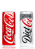 LONDON, UK - JUNE 9, 2017: Aluminium cans of Coca cola soft drink on white.The Coca-Cola Company, an American multinational bevera. LONDON, UK - JUNE 9, 2017 Royalty Free Stock Image