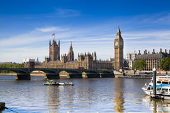 LONDON, UK - JUNE 24, 2014 - Big Ben and Houses of Parliament on Thames river Stock Photo