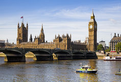 LONDON, UK - JUNE 24, 2014 - Big Ben and Houses of Parliament on Thames river Royalty Free Stock Photo
