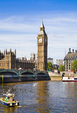 LONDON, UK - JUNE 24, 2014 - Big Ben and Houses of Parliament on Thames river Royalty Free Stock Photos