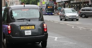 Black TX4 London Taxi Cab Parked In The Street. London, UK, June 1, 2019: Black TX4 London Taxi Cab Parked In The Street Of Brompton Road In The District Of stock video footage