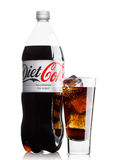 LONDON, UK - JUNE 9, 2017: Bottle and glass of Diet Coke soft drink on white.The Coca-Cola Company, an American multinational beve Royalty Free Stock Photography