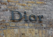 LONDON, UK - JUNE 02, 2017: DIOR BEAUTY BOUTIQUE LOGO ON BRICK WALL AT COVENT GARDEN IN LONDON. Royalty Free Stock Photography