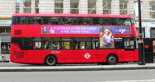 Double Decker Red Bus Side View. London, UK, June 1, 2019: Double Decker Red Bus Side View Parked On Piccadilly Road In The City Of Westminster In London, United stock video footage