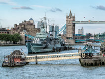 LONDON, UK - JUNE 14 : HMS Belfast anchored near Tower Bridge in Royalty Free Stock Photo