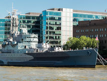 LONDON, UK - JUNE 14 : HMS Belfast anchored near Tower Bridge in Royalty Free Stock Photos