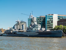 LONDON, UK - JUNE 14 : HMS Belfast anchored near Tower Bridge in Stock Photos