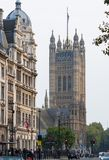 Houses of Parliament street view. London, UK. London, UK - June 27, 2017:  Houses  Parliament and Parliament tower street view. London, UK Royalty Free Stock Photography
