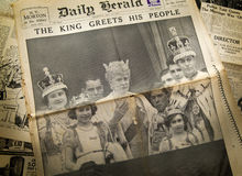 LONDON, UK - JUNE 16, 2014 King cheering his people, Royal family on front of Vintage English newspaper 13th of May, 1937 year. LONDON, UK - JUNE 16, 2014 King Stock Images