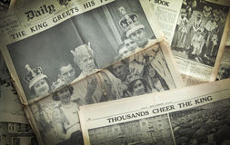 LONDON, UK - JUNE 16, 2014 King cheering his people, Royal family on front of Vintage English newspaper 13th of May, 1937 year Royalty Free Stock Photos