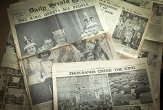 LONDON, UK - JUNE 16, 2014 King cheering his people, Royal family on front of Vintage English newspaper 13th of May, 1937 year Stock Photo