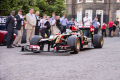 London, UK - June 23, 2014: Lotus Formula 1 car rolls into park for wheel spin demonstration Stock Image