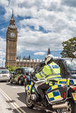 LONDON, UK - JUNE 11, 2014: A motion blurred motor cycle cop spe Royalty Free Stock Photography