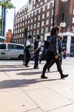 Oxford Street. Two unrecognizable police officers patrolling in the city. LONDON, UK - JUNE 9, 2015: Oxford Street. Two unrecognizable police officers in stock photo
